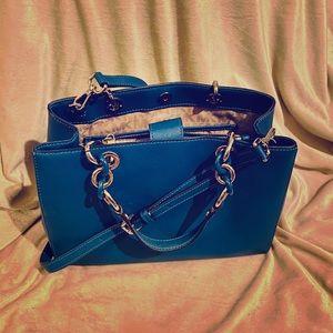 Boss it up w/ this MK blue & silver chain handbag